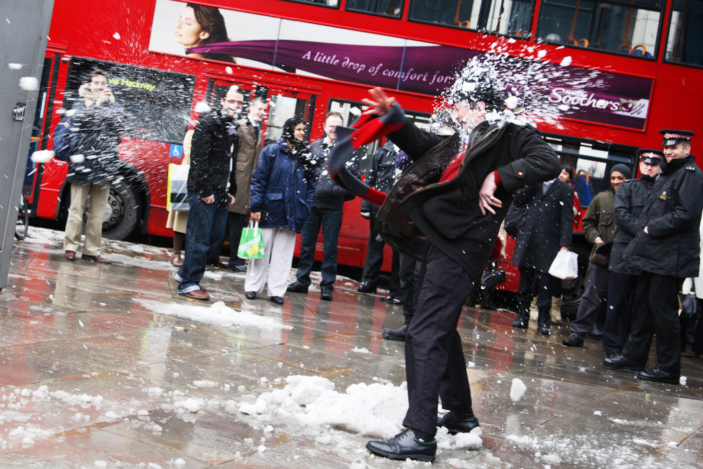 Snow ball fight between Bankers at Royal Bank of Scotland and the People.